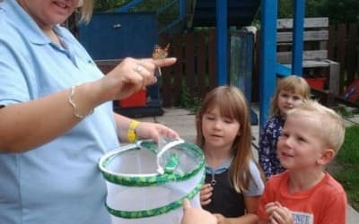 Children learn about and release the butterflies